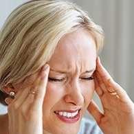 Person med hovedpine